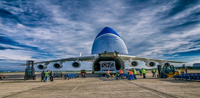 back of air plane being loaded with cargo