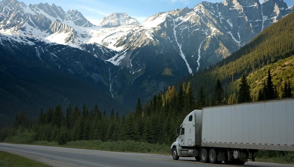 truck driving through mountains