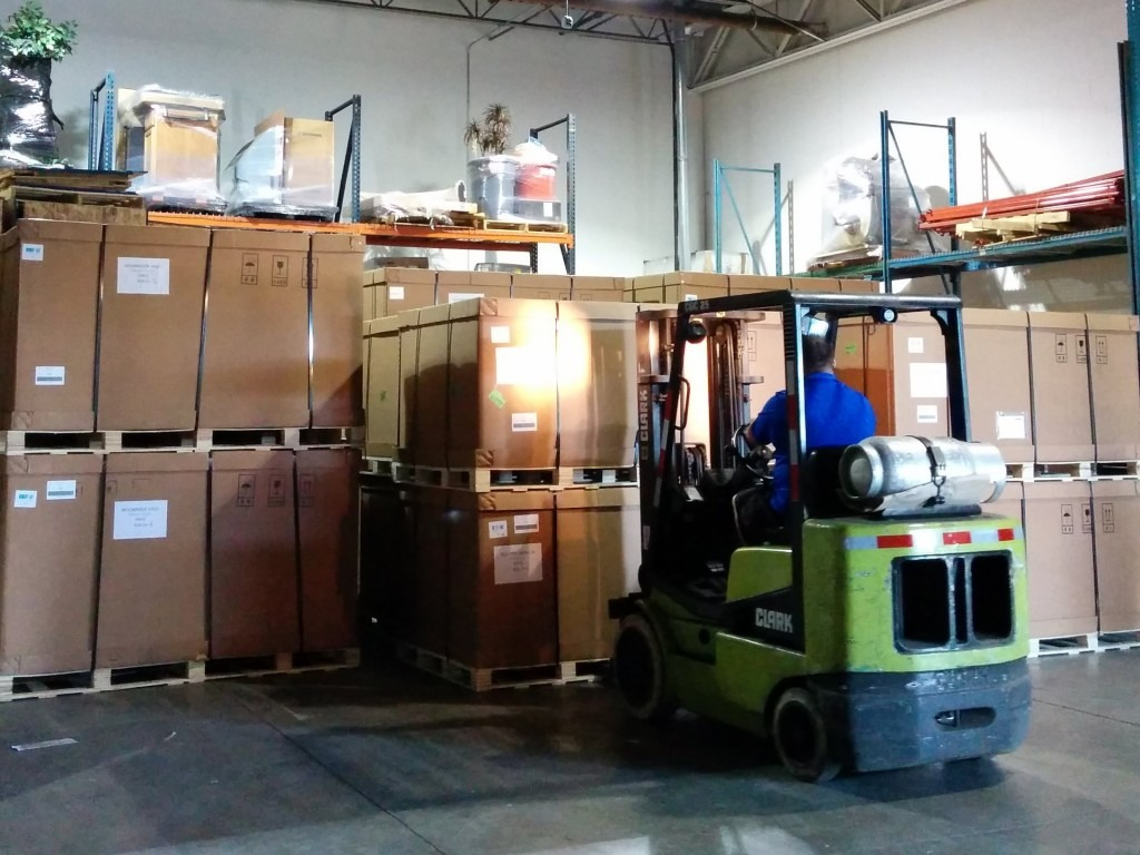 fork lift moving boxes on pallets