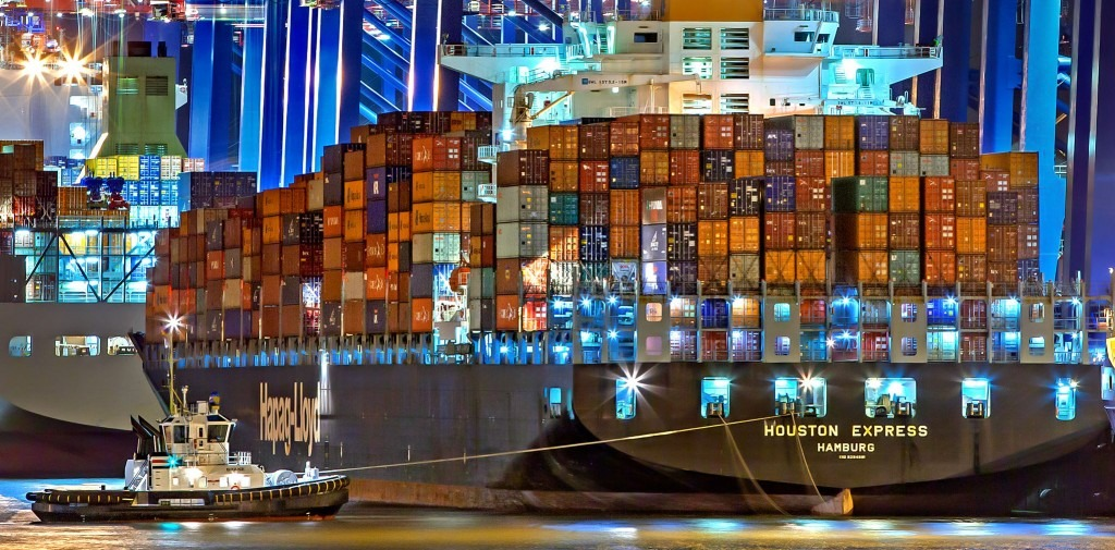 houston express loaded with shipping containers at night