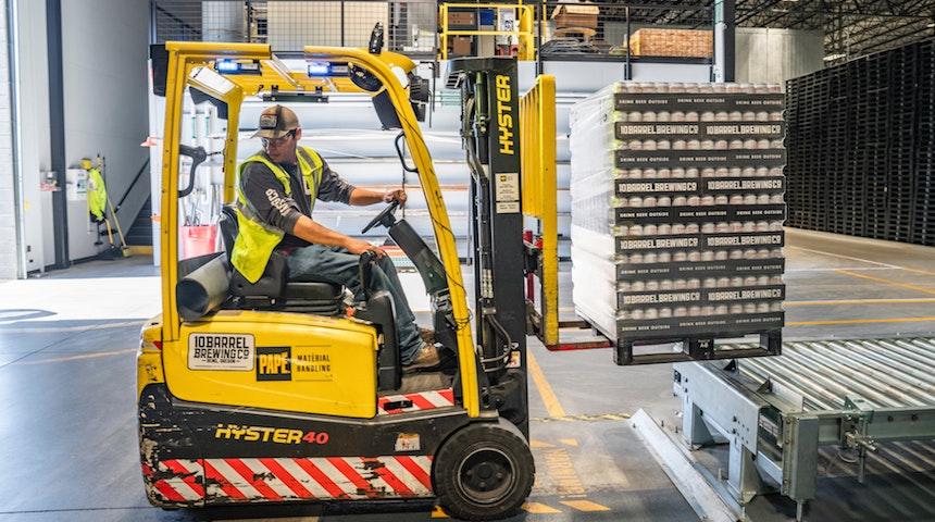 icat logistics person using forklift - Warehousing