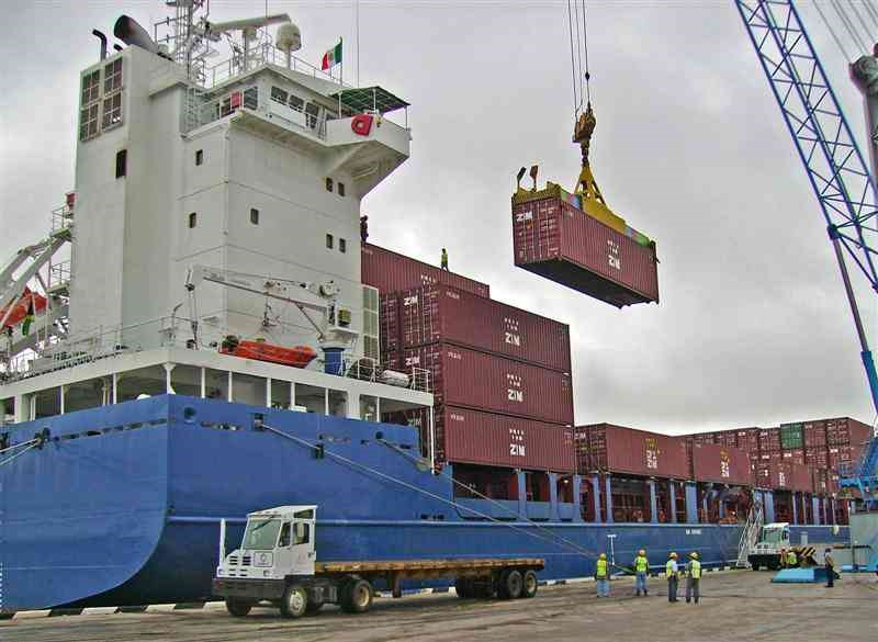 ship being loaded with shipping containers